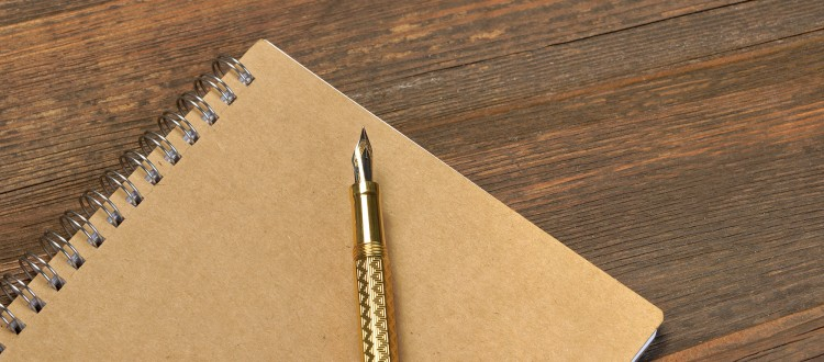 Memoirs. Notepad With Gold Fountain Pen On The Old Wood Table