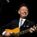 Lyle Lovett performer. Playing guitar.